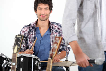 Young man playing drums photo