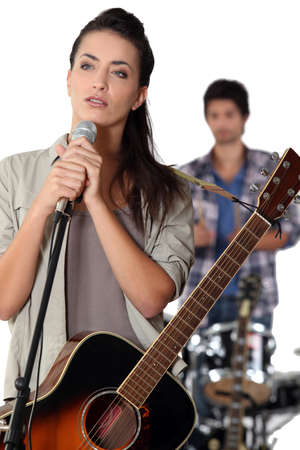 stardom: brunette with microphone rehearsing Stock Photo