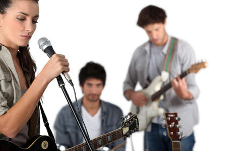 vocalist: Young rock band with female vocalist Stock Photo