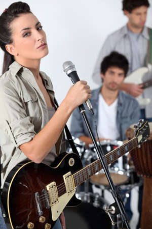 Female singer in a band photo