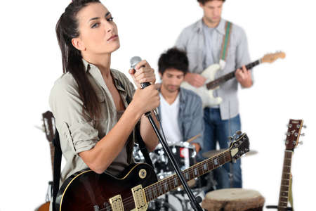 Female vocalist in a band photo
