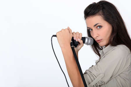 to interpret: Woman with microphone Stock Photo