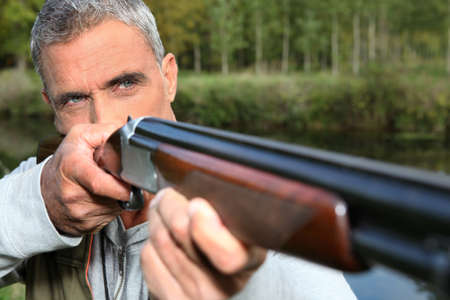 silvered: hunter shooting Stock Photo