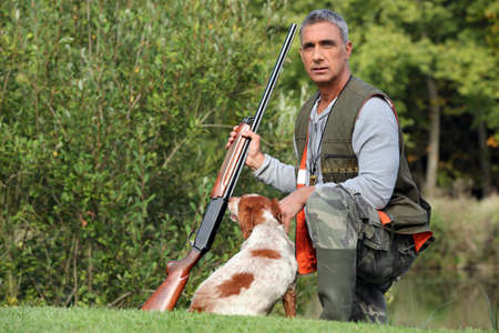 Hunter with dog photo
