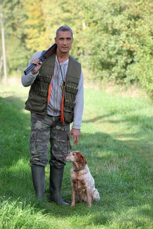 Hunter and dog photo