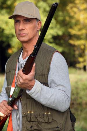 hunting rifle: Hunter with rifle