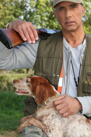 cap hunting dog: portrait of a hunter Stock Photo