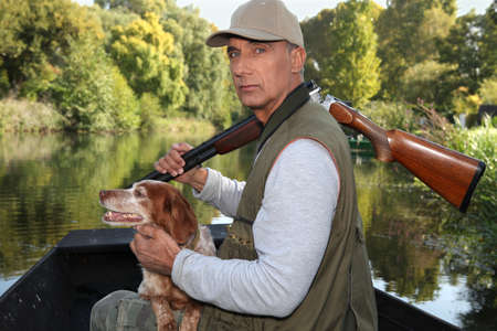 fisherman boat: Hunter with his dog Stock Photo