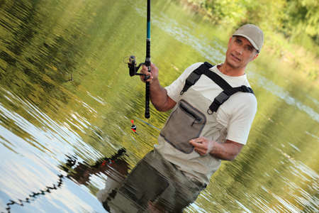 impervious: Oblique image of a fisherman on a river