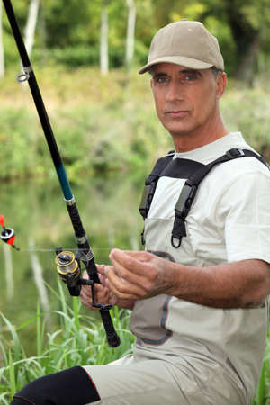 impervious: Fisherman with rod