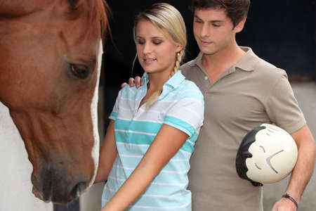 Teens with horse photo