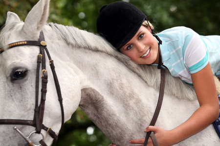 Young woman and her horse photo