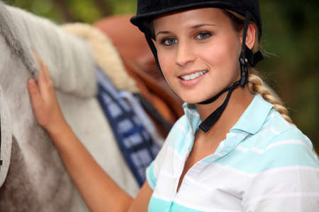 equitation: A horseback rider with her horse