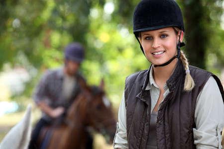 horse blonde: Girl horse riding Stock Photo