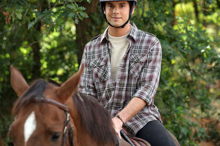 shoulder ride: young riding horse