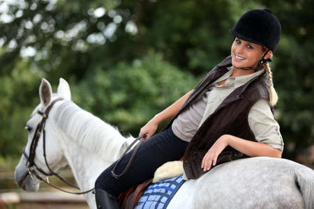 girl on horse: Woman on a horse