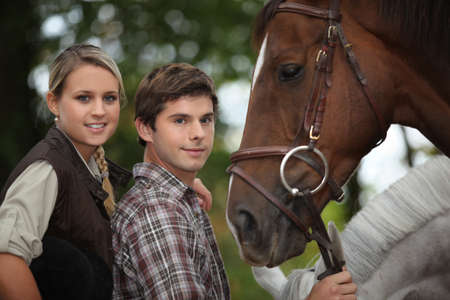 two young people and a horse photo