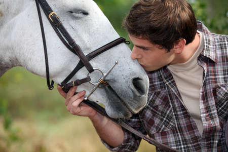 A man patting his horse photo