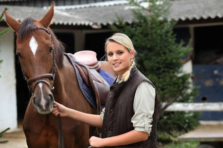 Blonde girl with horse photo