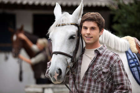 Young man looking after horses photo