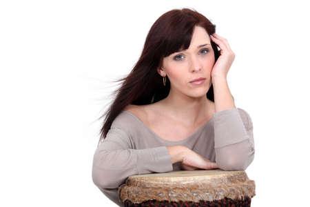 bongo: Brunette posing with bongo