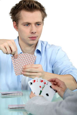 Young men playing cards photo