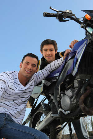 Father and son with motorcycle photo