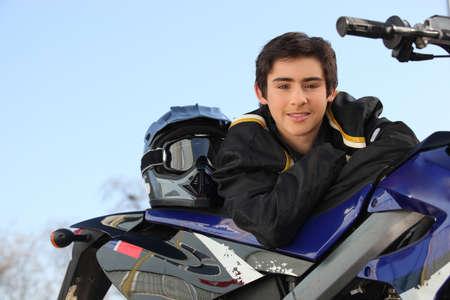 Boy with a motorbike photo
