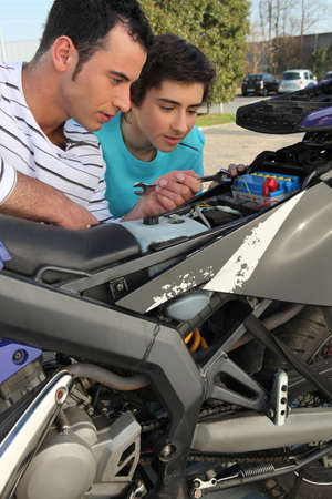 Father and son with motorcycle Stock Photo - 13924540