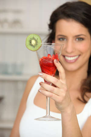 Woman with glass of strawberries photo