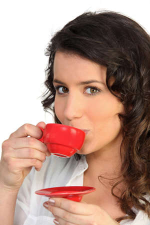 drink me: Woman holding espresso