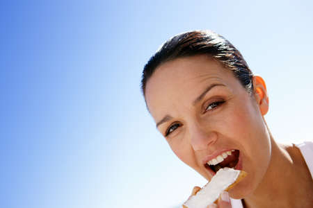 hair tied: Woman eating a rusk with butter