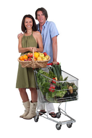 Couple with a basket and trolley full of fresh produce Stock Photo - 13949590
