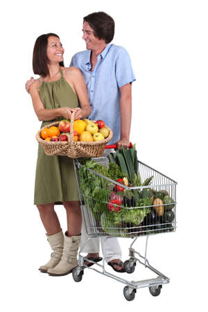 portrait of a couple buying fruit and vegetables photo