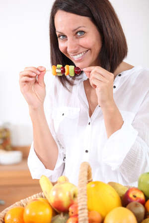 woman eating fruits Stock Photo - 13966193