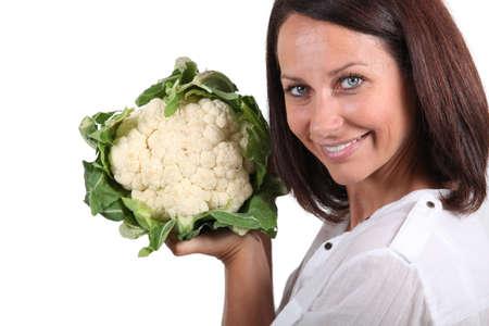 head of cauliflower: woman holding a cauliflower head Stock Photo
