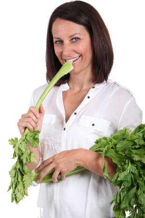 Woman eating a branch of celery photo