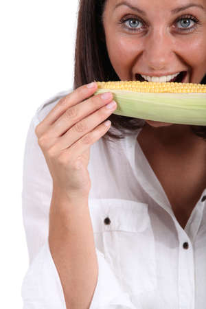 Woman eating corn on the cob Stock Photo - 13951593