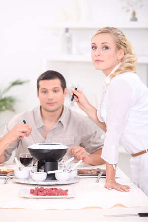 meat lover: Friends eating fondue