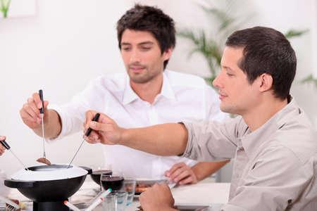 guys eating fondue photo