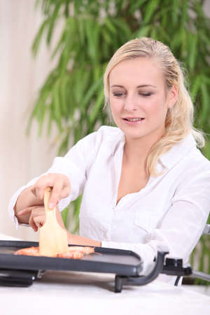 wood turning: Woman cooking on grill