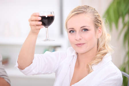 factions: Woman toasting with red wine Stock Photo