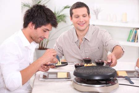Having raclette for dinner photo