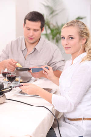 Couple eating a raclette photo