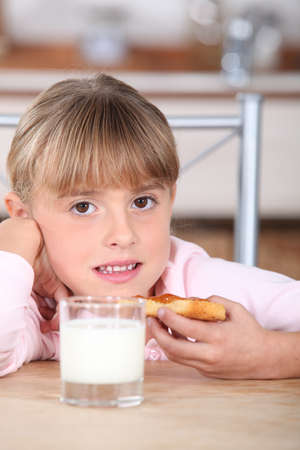 Girl with a slice of bread Stock Photo - 13966168