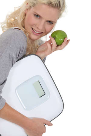regimen: Blond woman with scales Stock Photo