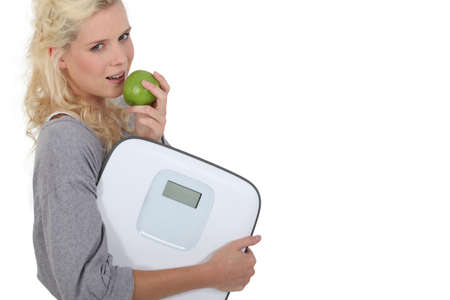 Healthy woman eating apple photo