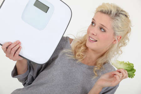 weigh: Woman trying to lose weight