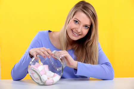 Gourmand woman eating marshmallows Stock Photo - 13967210