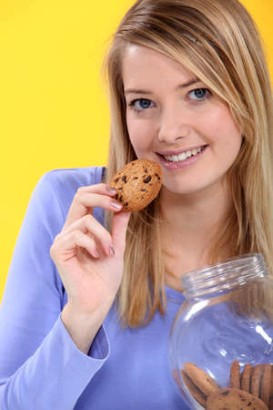 round face: Woman eating a cookie